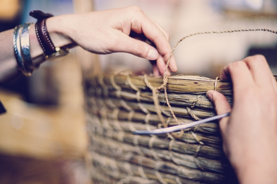Gemma Stratton weaving Orkney chair back with ti kouka cabbage tree leaves. Image by Justyn Denney